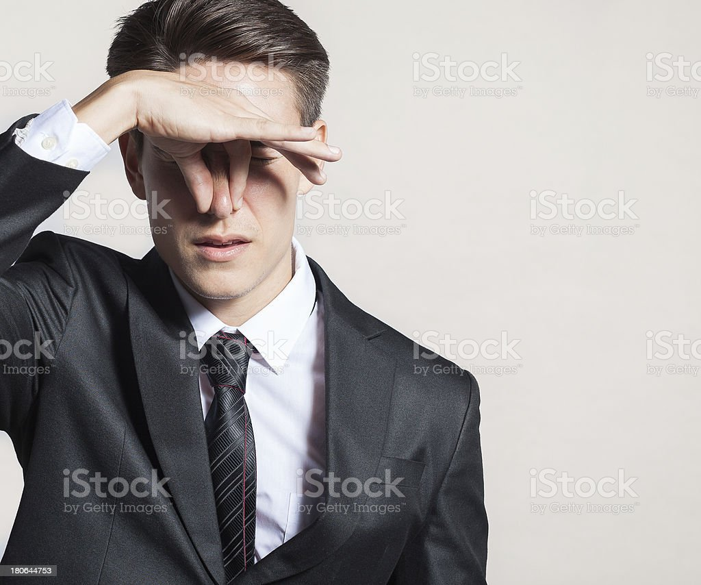 Businessman with disgusted expression. Studio shoot. stock photo