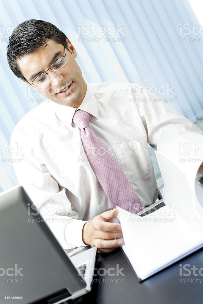 Businessman with documents at office stock photo