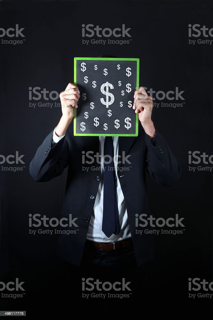 Businessman with Dollar sign drawn on slate royalty-free stock photo