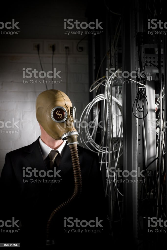 Businessman With Dollar Signs in Eyes Wearing Gas Mask stock photo