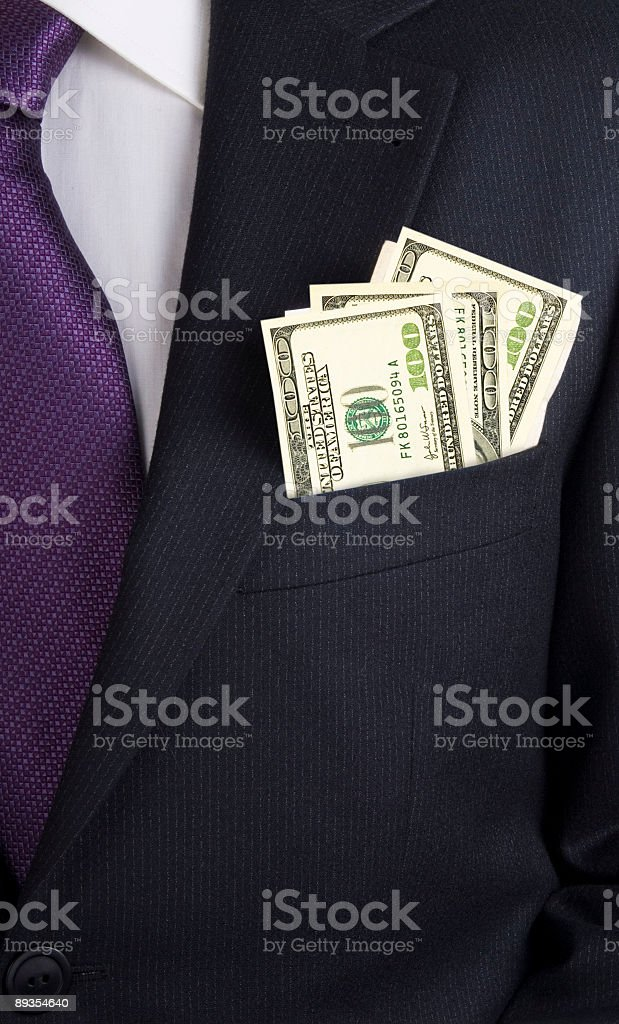 Businessman with dollars in his jacket pocket stock photo