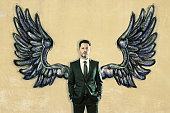 Businessman with drawn wings