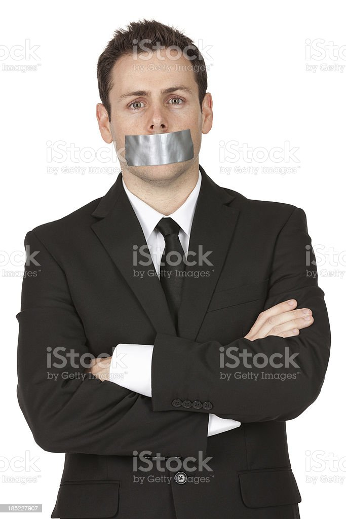 Businessman with duct tape on his mouth stock photo