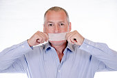 Businessman with duct tape on his mouth