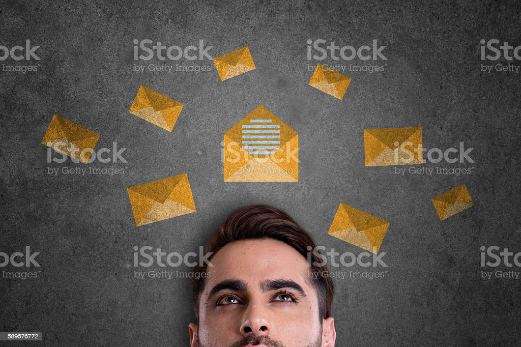 Businessman with E-mail icons stock photo