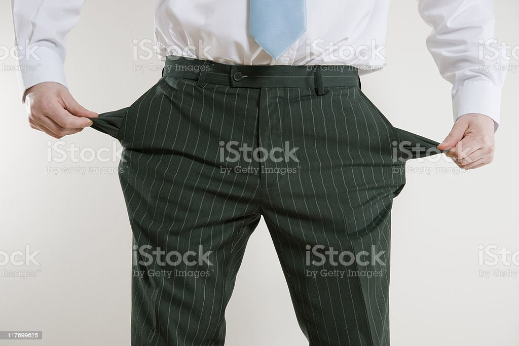 businessman with empty pockets royalty-free stock photo