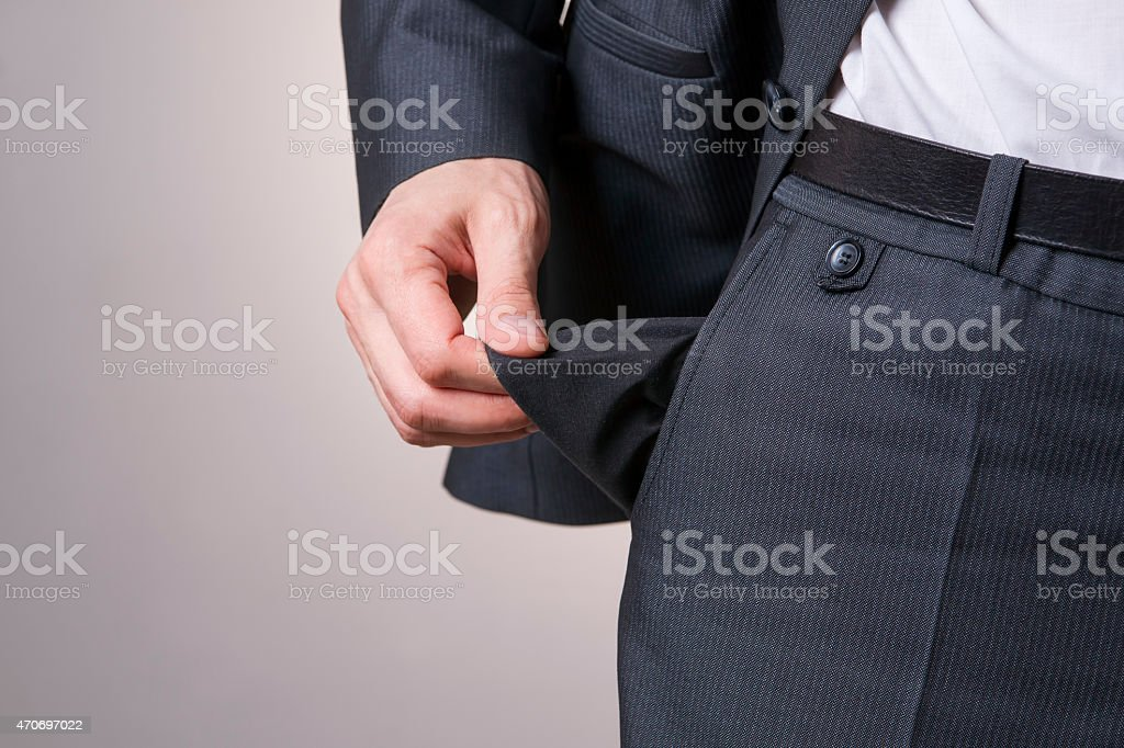 A businessman with empty pockets representing bankruptcy stock photo
