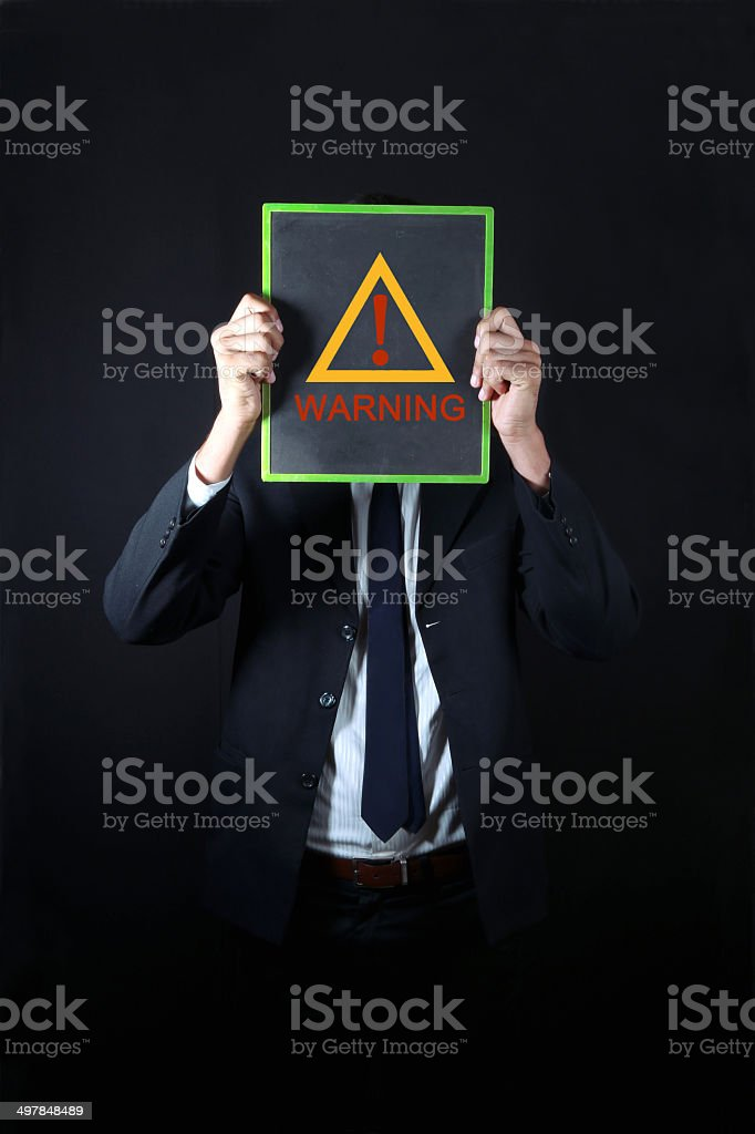 Businessman with exclamation sign royalty-free stock photo