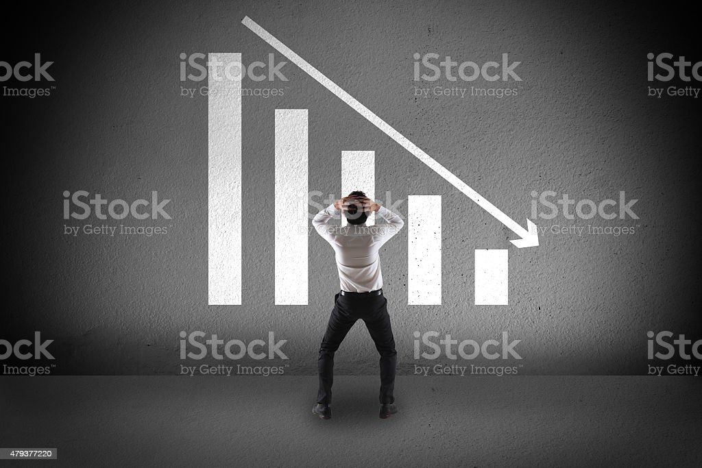 Businessman with failure chart stock photo