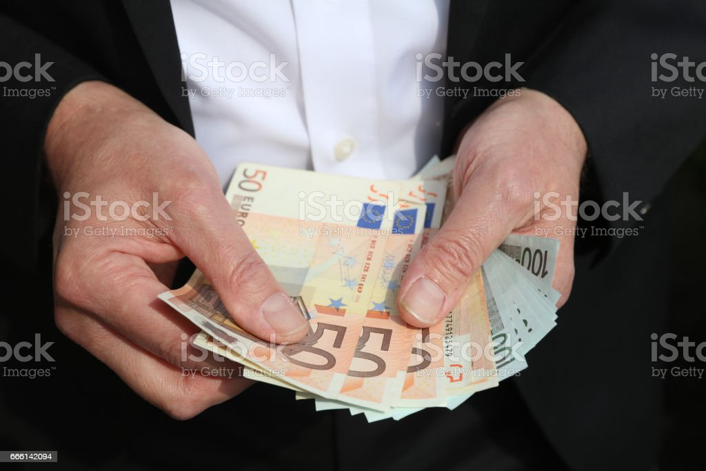 Businessman with Fifty and One Hundred Euro Banknotes stock photo