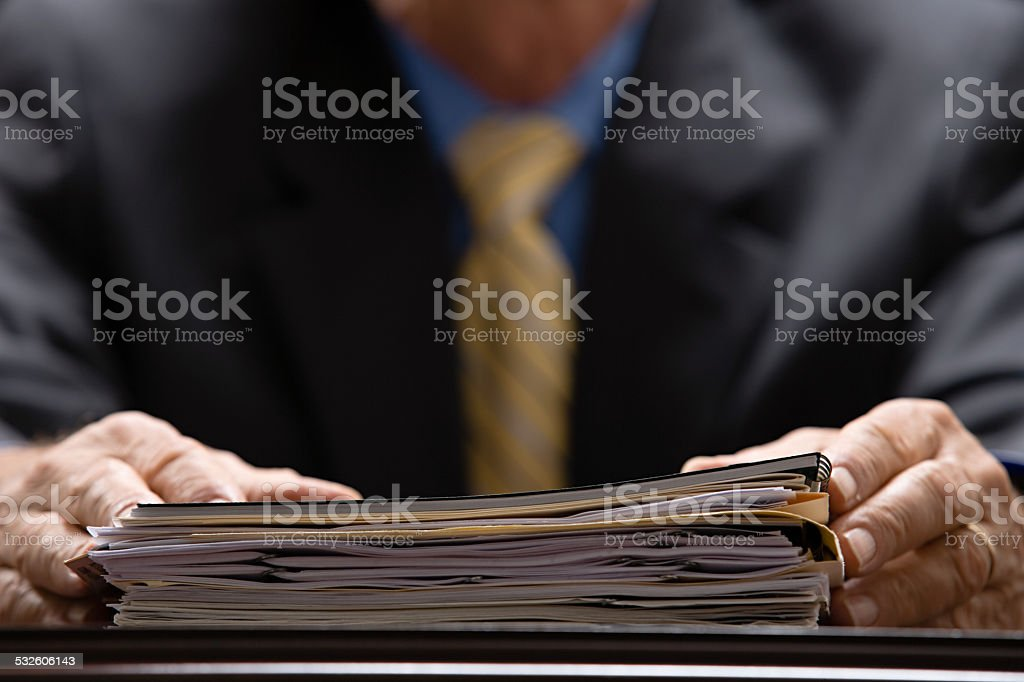 Businessman with files stock photo