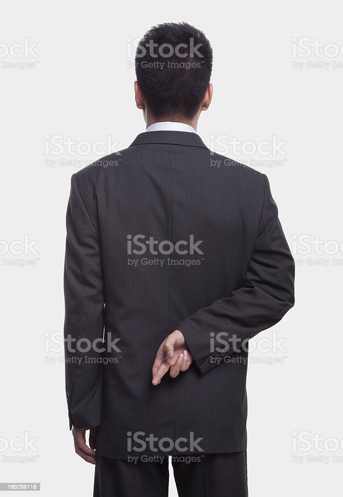 Businessman with Fingers Crossed royalty-free stock photo