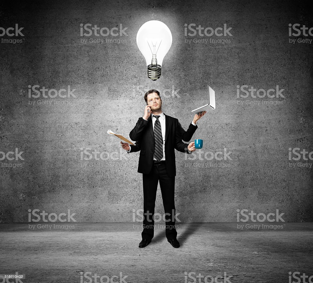 businessman with four hands stock photo