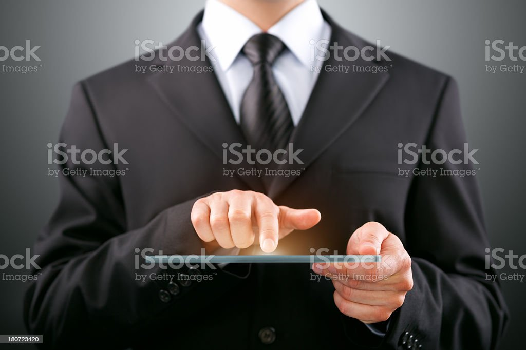 Businessman with futuristic digital tablet royalty-free stock photo