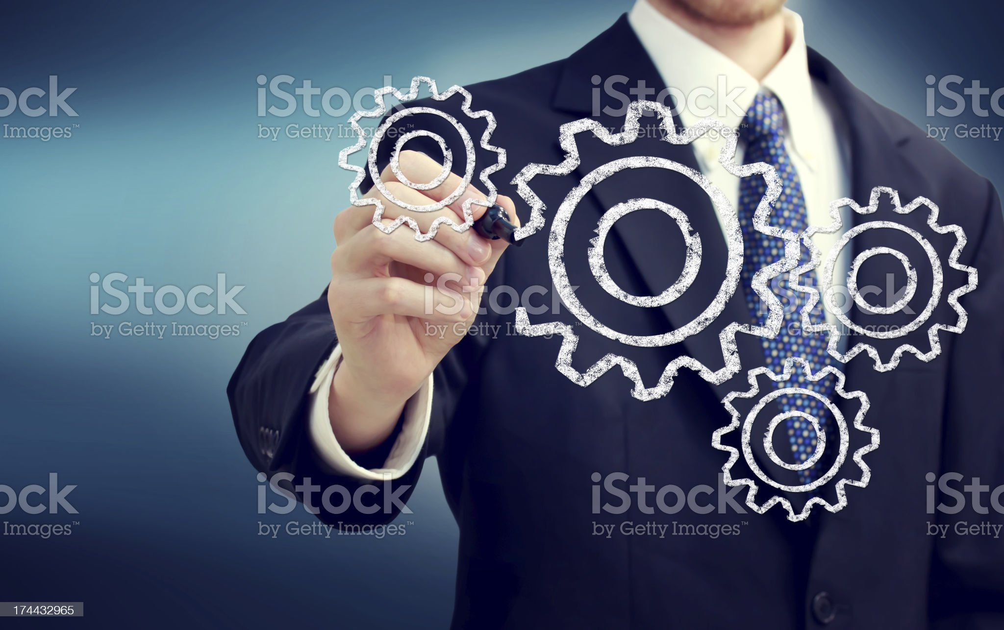 Businessman with gears royalty-free stock photo