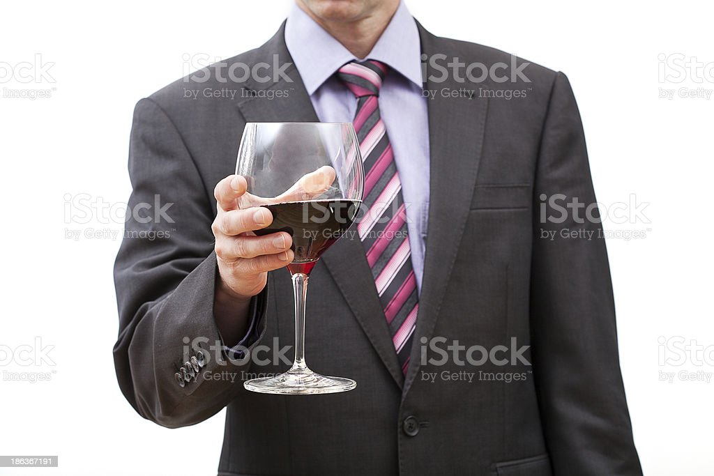 Businessman with glass of red wine royalty-free stock photo