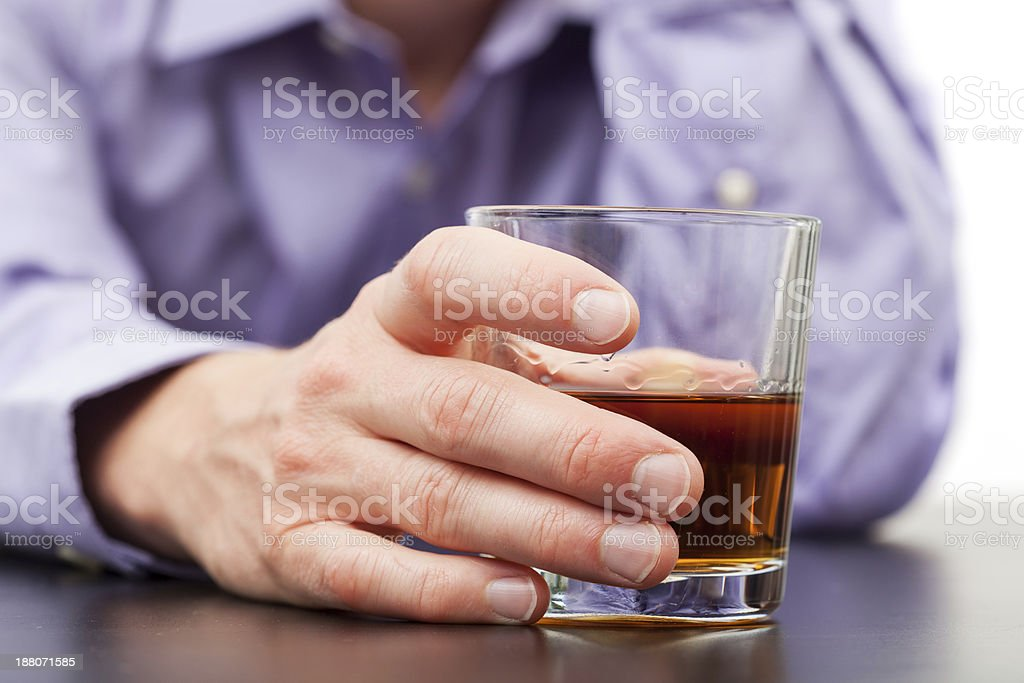 Businessman with glass of whisky stock photo