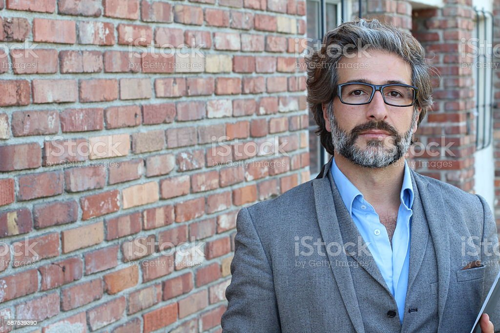 Businessman with glasses in classic suit stock photo