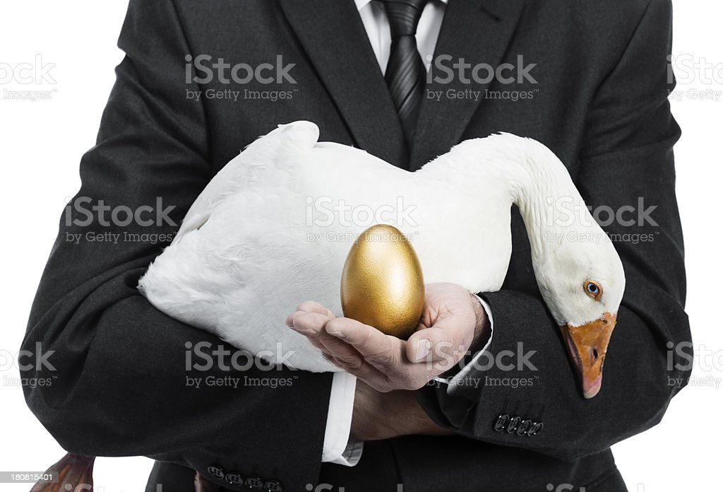 Businessman with golden egg stock photo
