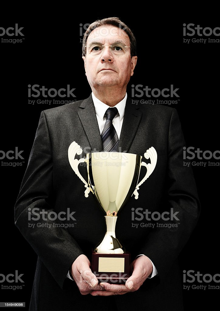 businessman with golden trophy royalty-free stock photo