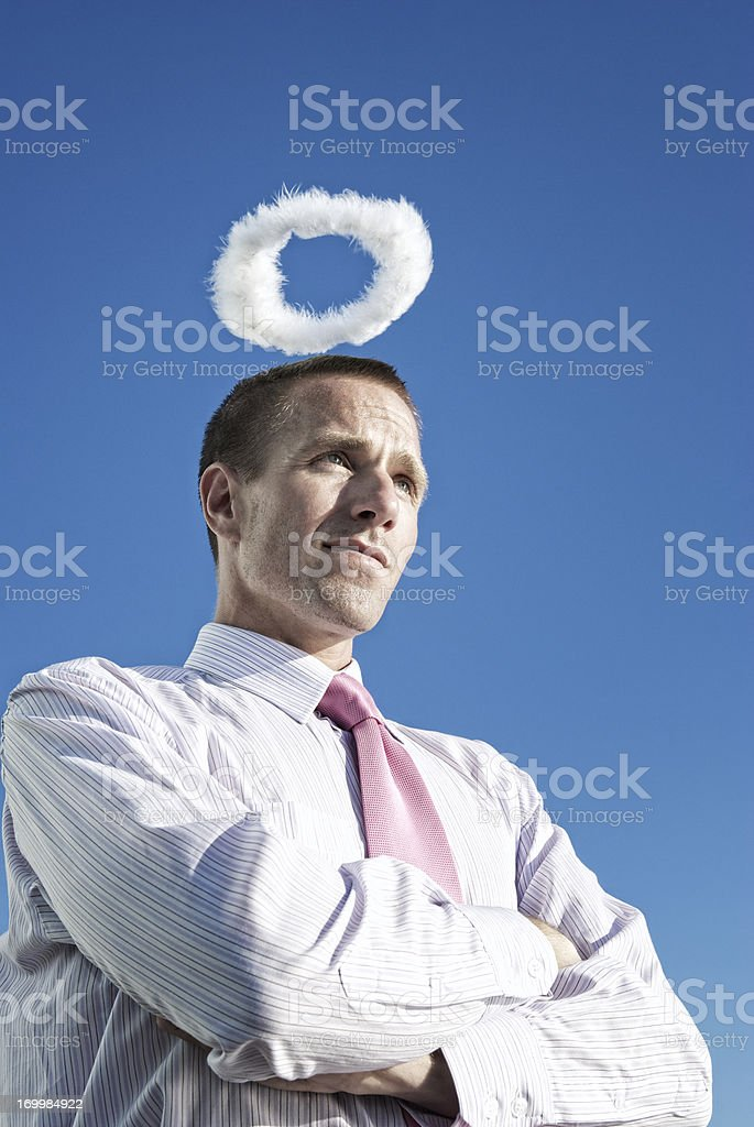 Businessman with Halo and Folded Arms Blue Sky royalty-free stock photo