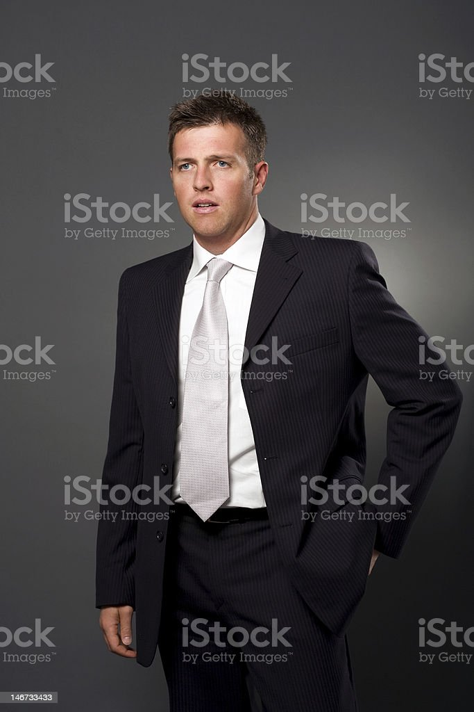 Businessman with hand in pocket stock photo