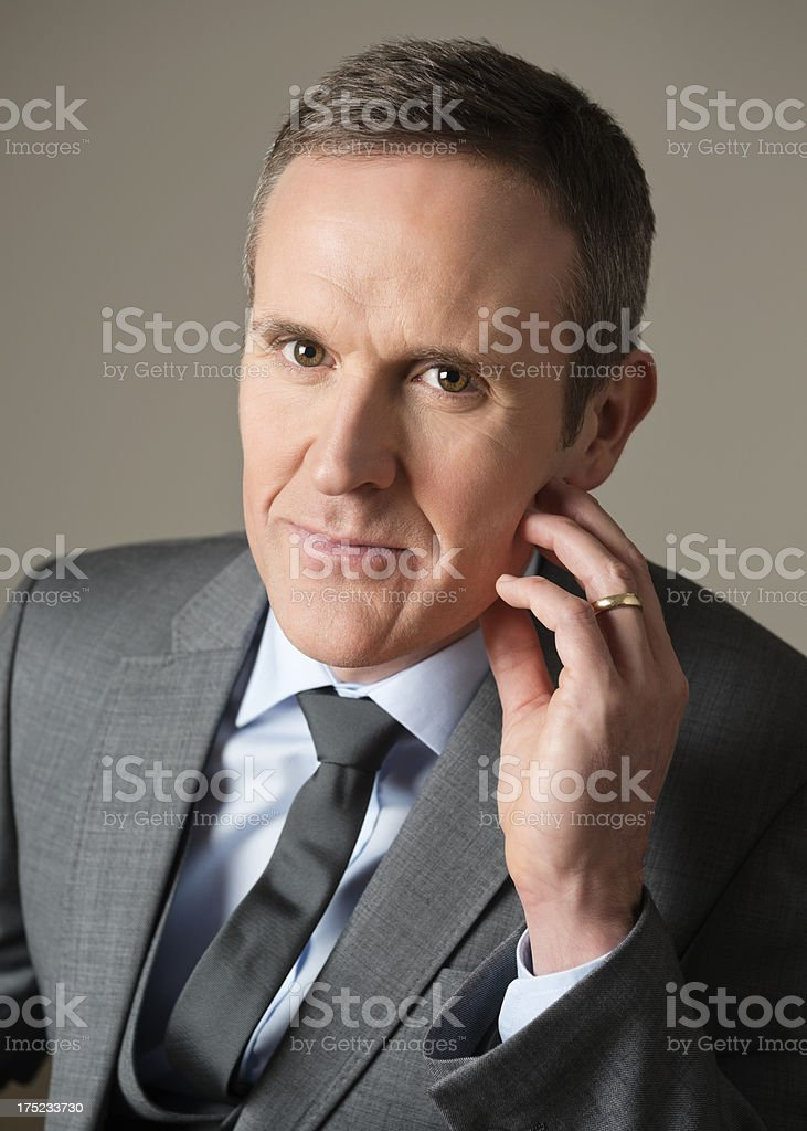 Businessman With Hand On Chin royalty-free stock photo