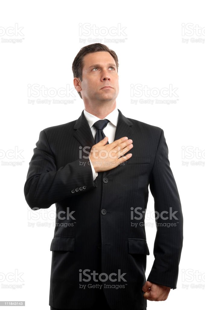Businessman with Hand over Heart Isolated on White Background royalty-free stock photo