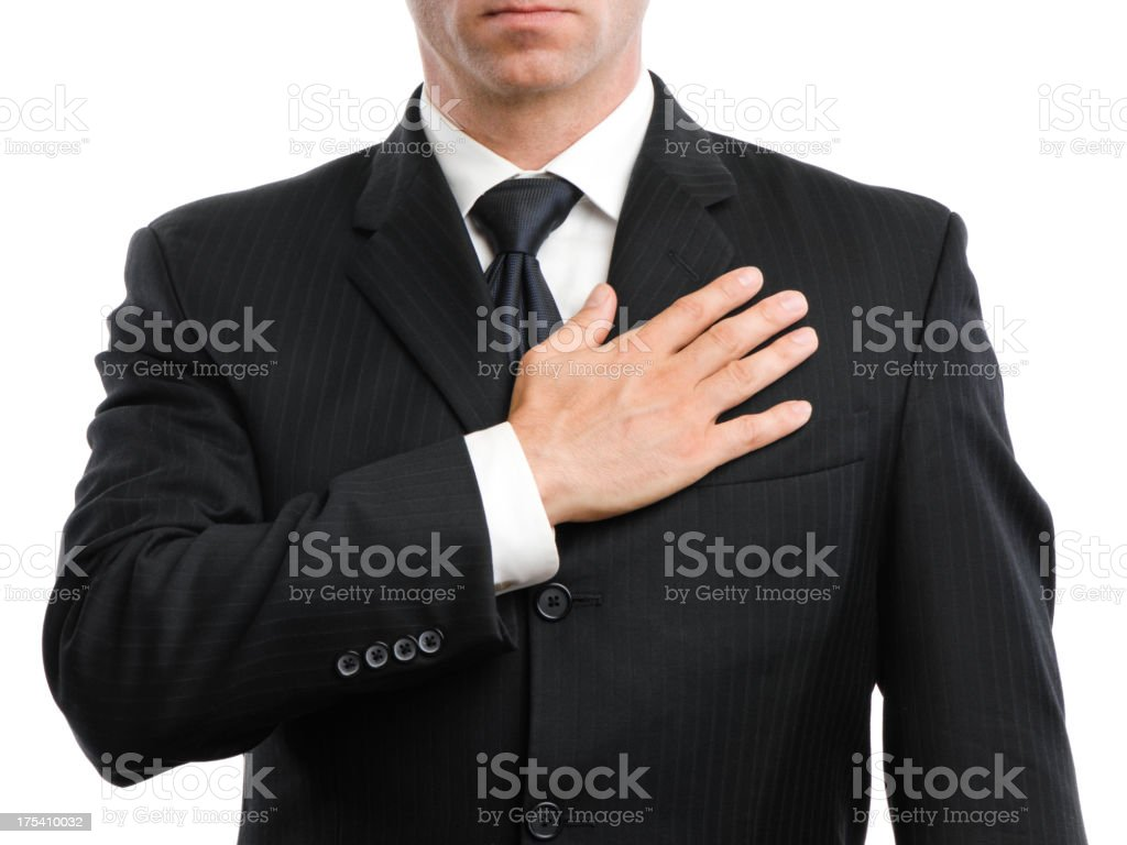 Businessman with Hand Over Heart on White stock photo