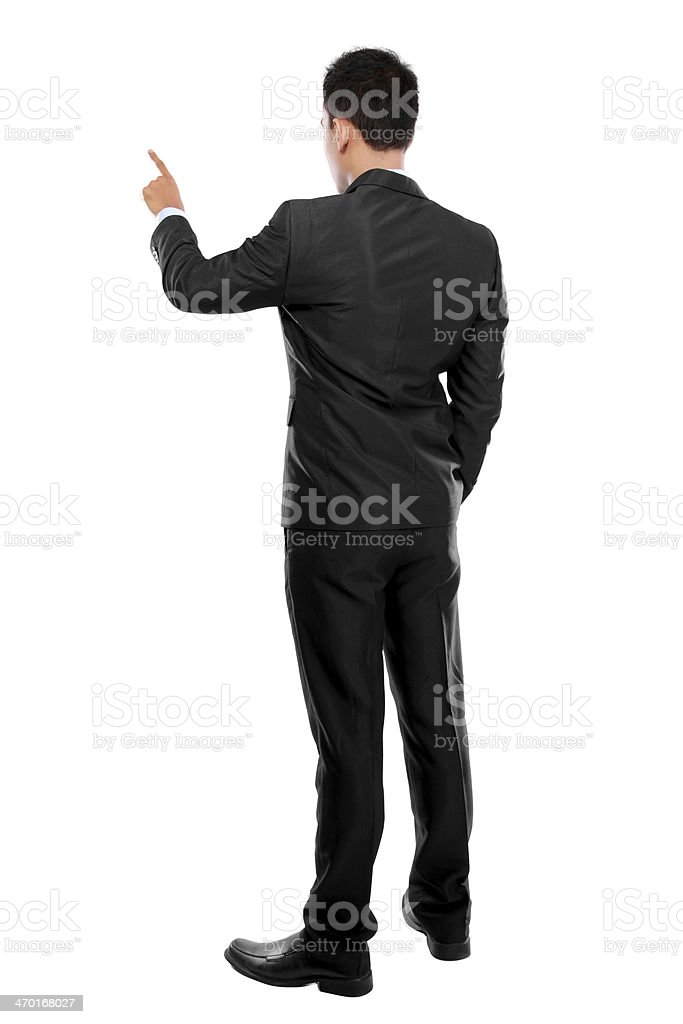 Businessman with hand pointing at a virtual screen stock photo