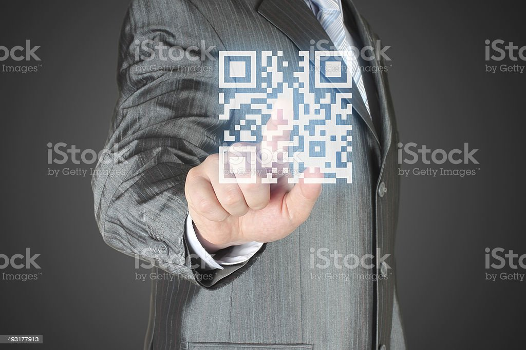 Businessman with hand pressing virtual qr code button stock photo