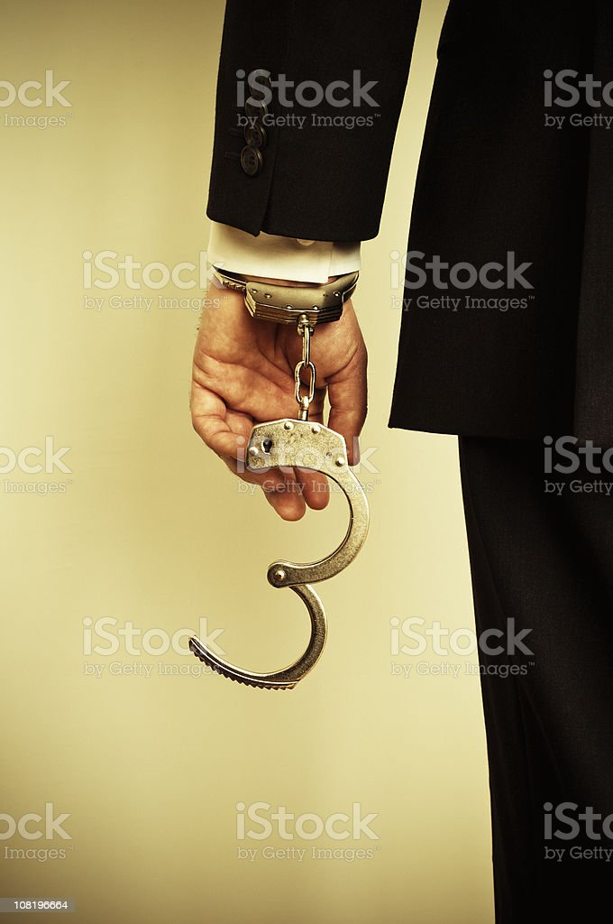 Businessman with Handcuffs royalty-free stock photo