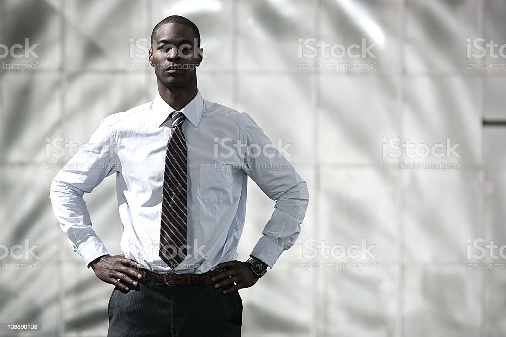 Businessman with hands on hips stock photo