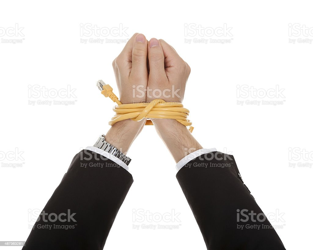 Businessman with hands tied in network cable stock photo