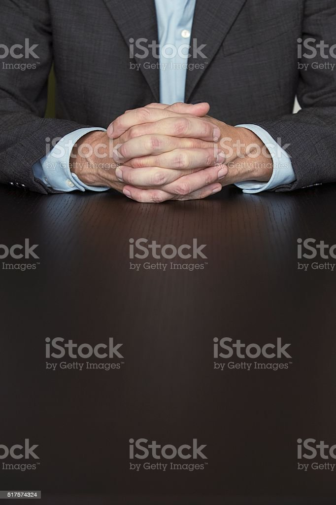 Businessman with hands together stock photo