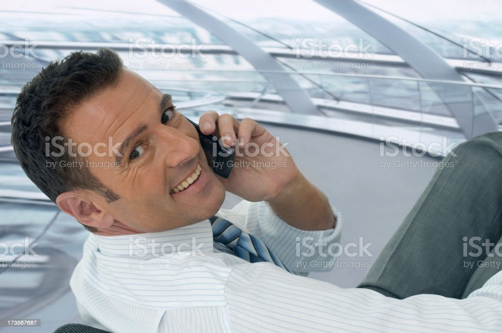 Businessman with handy royalty-free stock photo
