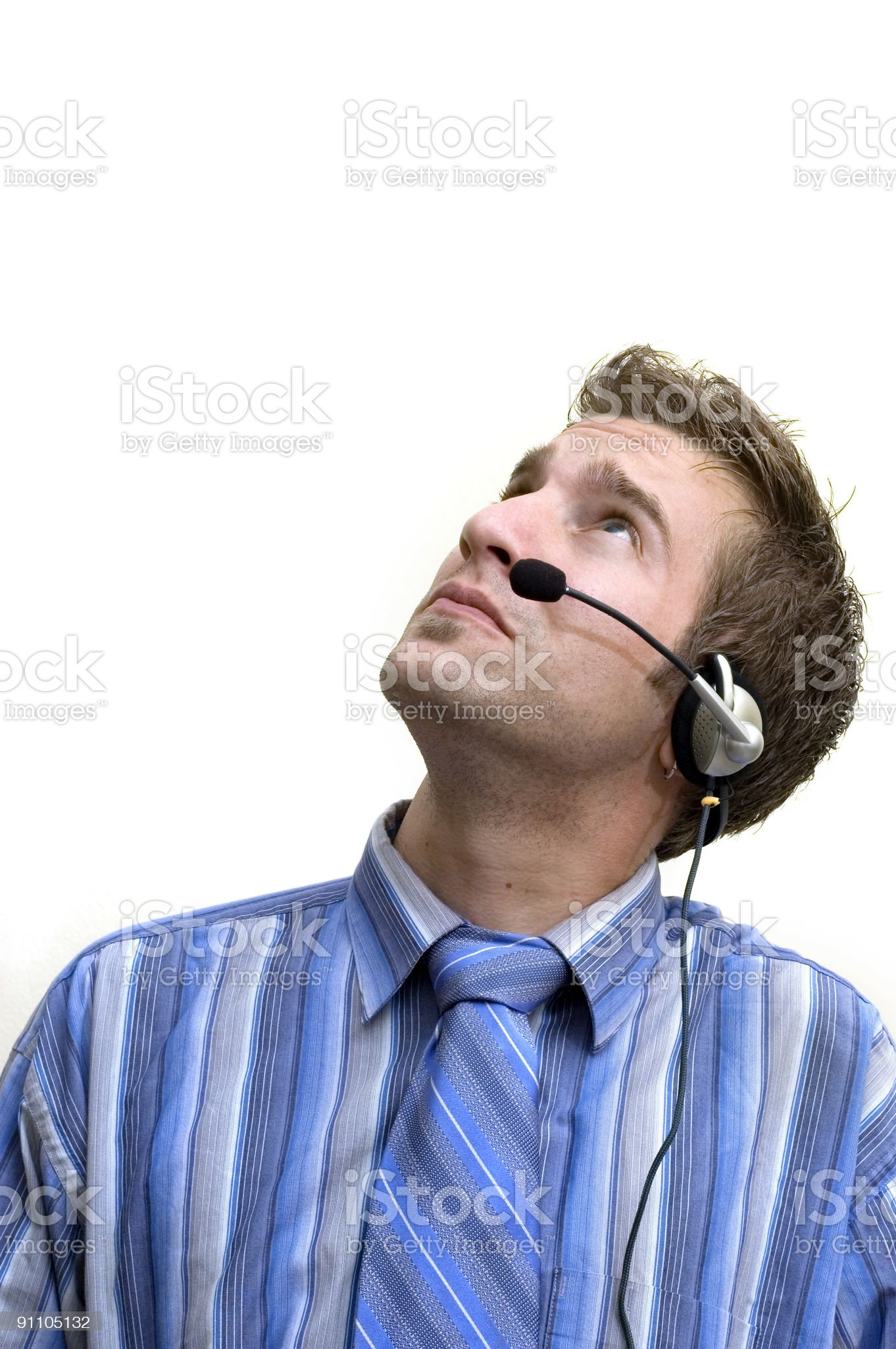 businessman with headset looking up royalty-free stock photo