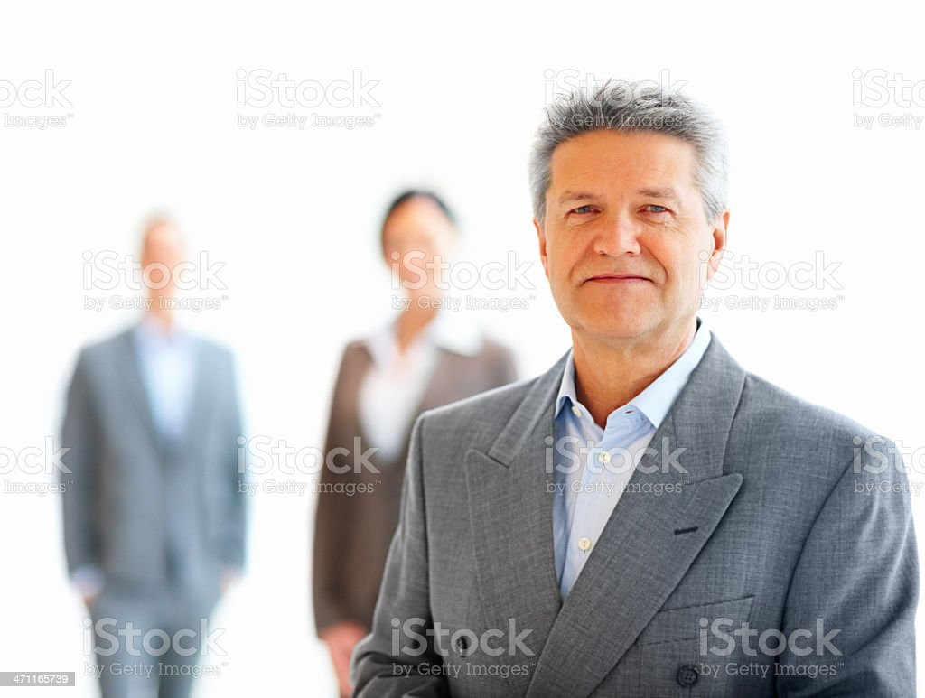 Businessman with his colleagues standing in background royalty-free stock photo