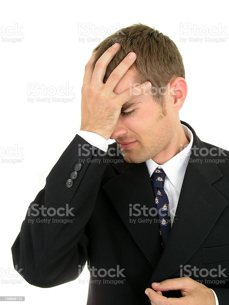 Businessman with his hand on his head royalty-free stock photo