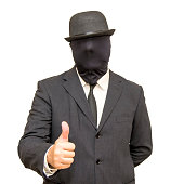 Businessman with his head hidden by a balaclava turned and