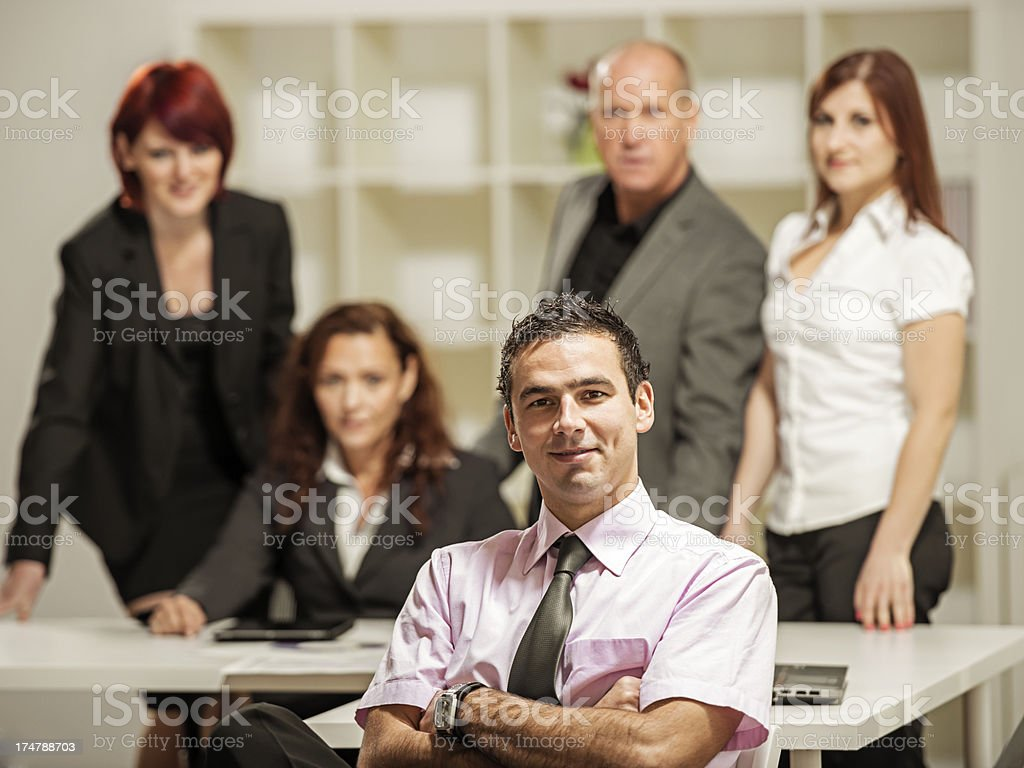 Businessman with his team in the background royalty-free stock photo