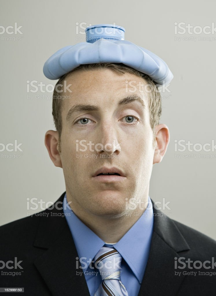 Businessman with Ice Pack royalty-free stock photo