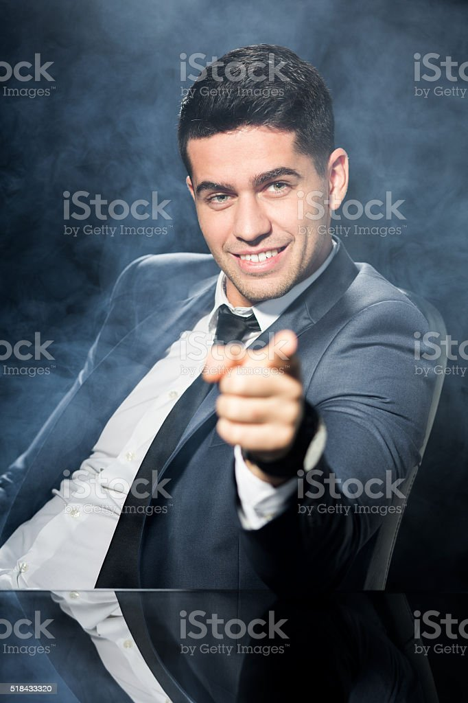 Businessman with index finger pointing stock photo