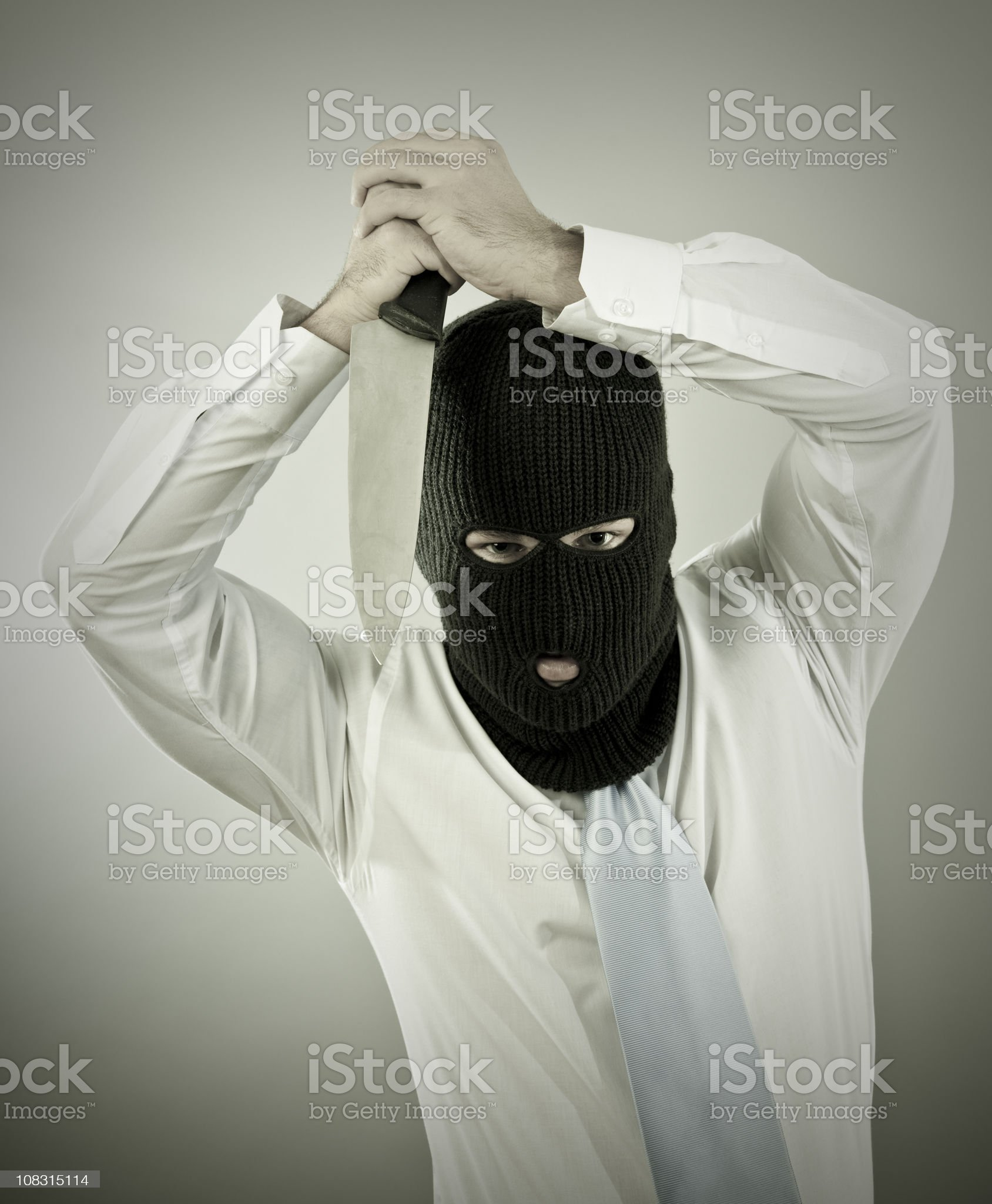 Businessman with knife royalty-free stock photo