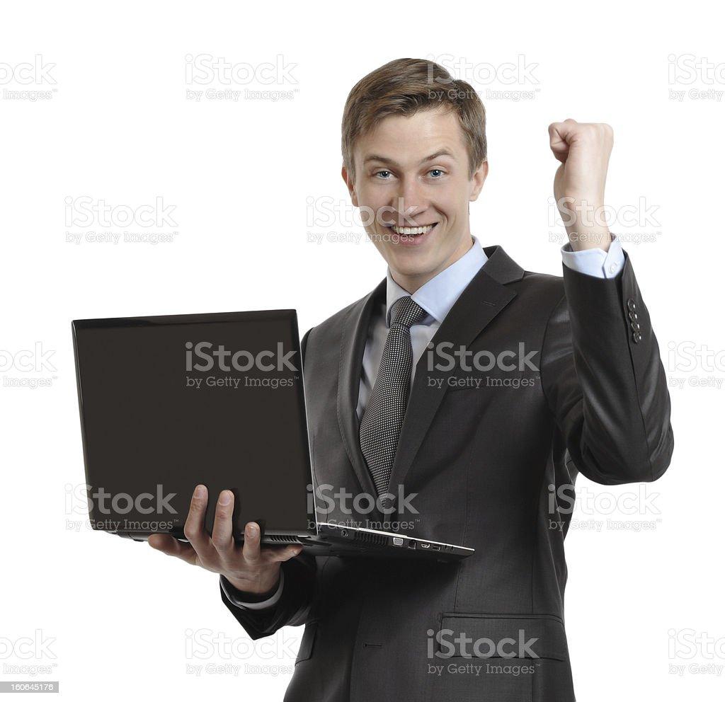 businessman with laptop celebrating winning royalty-free stock photo