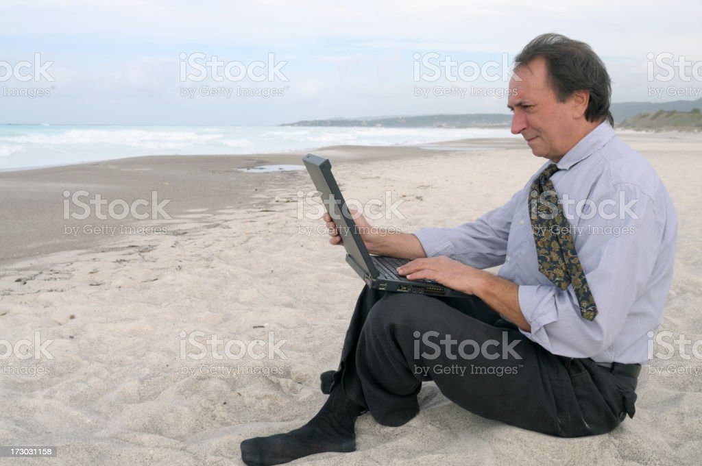 Businessman with Laptop on the Beach royalty-free stock photo