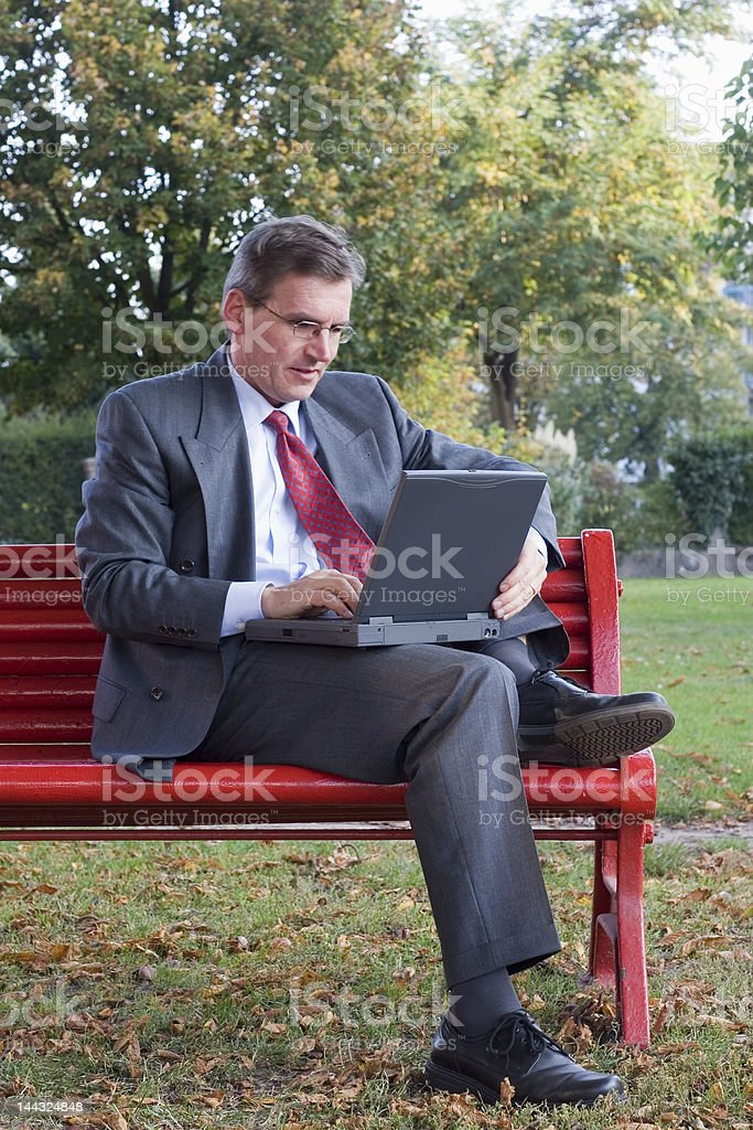 Businessman with laptop outside royalty-free stock photo