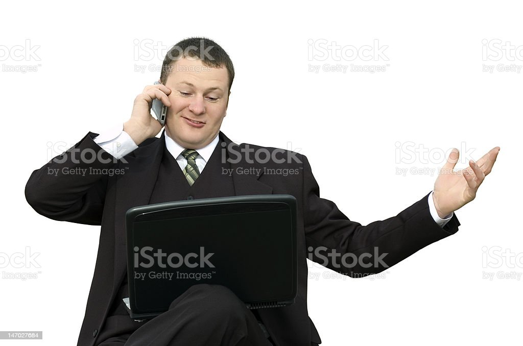 businessman with laptop talking on phone royalty-free stock photo
