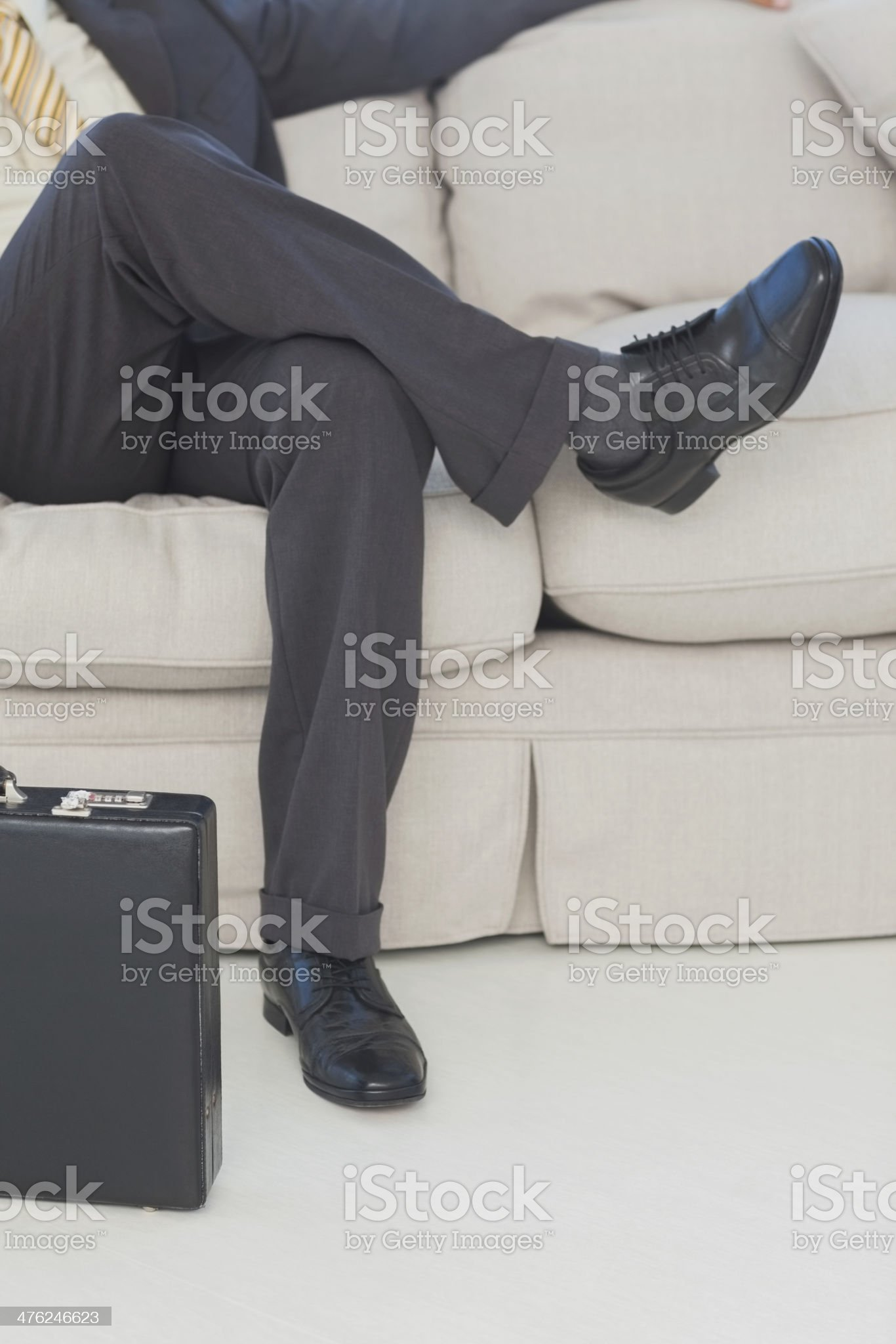 Businessman with legs crossed on couch royalty-free stock photo