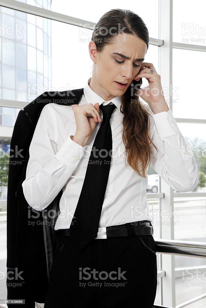 Businessman with long hair talking on his cell phone royalty-free stock photo